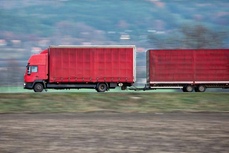 red-camion-truck-goes-fast-on-a-road-panned