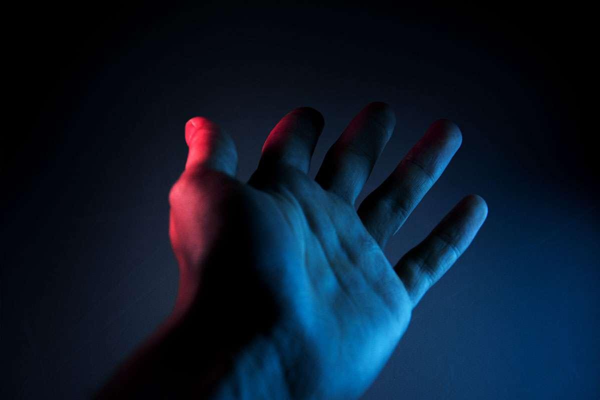 Hand in fluorescent light