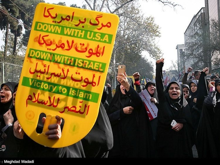 Iranian women gather to mark the anniversary of the seizure of the US Embassy
