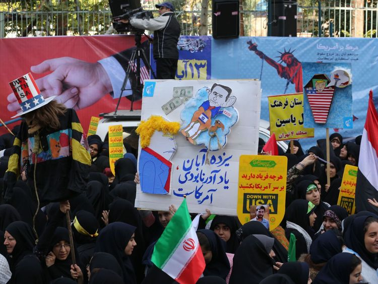Iranian protesters demonstrate outside the former US embassy in the Iranian capital Tehran