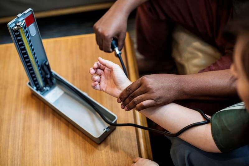 nurse-checking-the-blood-pressure