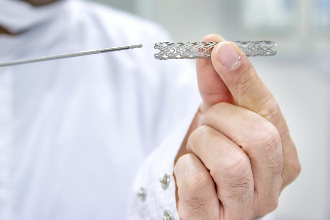 Doctor holding up heart stent