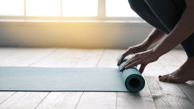 rolling-out-yoga-matt,-calming-and-toning-yoga---week-one-by-healthista.com