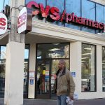 CVS shares tumble as forecast takes a hit from investments in Aetna