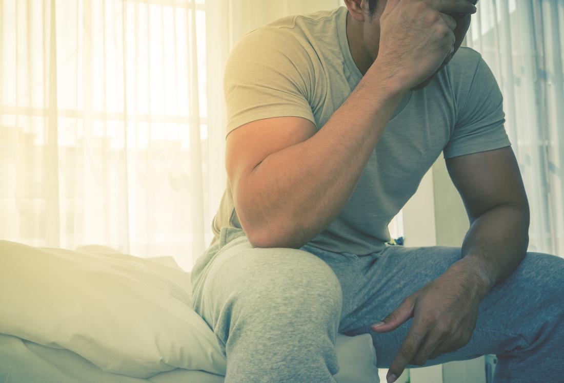 man in pajamas feeling tired