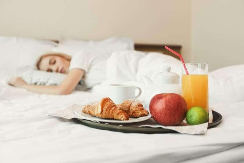 closeup-of-breakfast-in-front-of-sleeping-woman