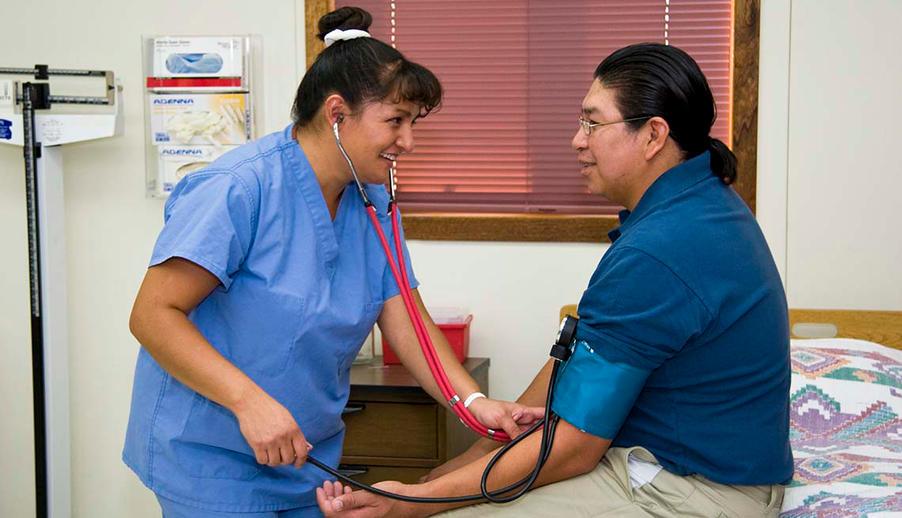 nurse treats native American patient