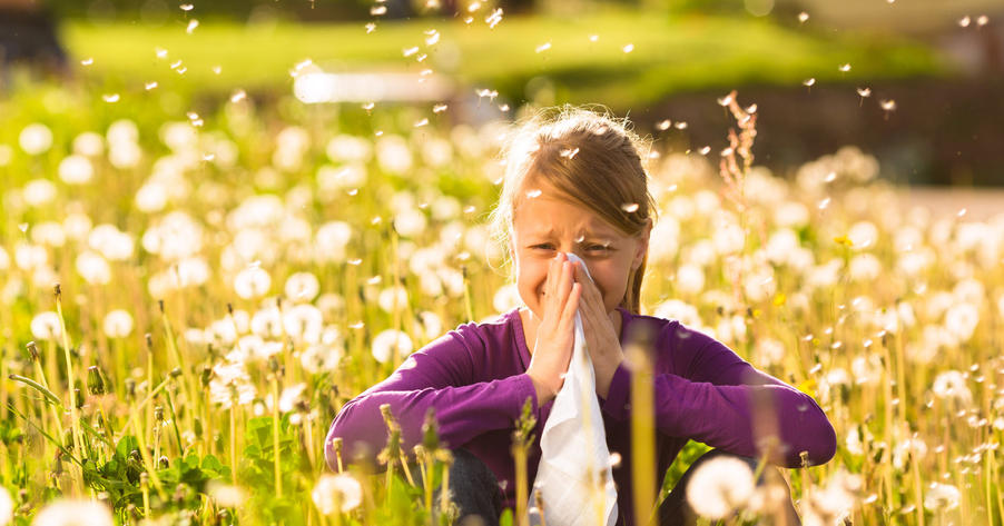 girl in field suffering from allergies